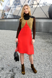 Brit Marling went for a vibrant retro look in a tricolor Louis Vuitton dress layered over a brown turtleneck during the label's fashion show.