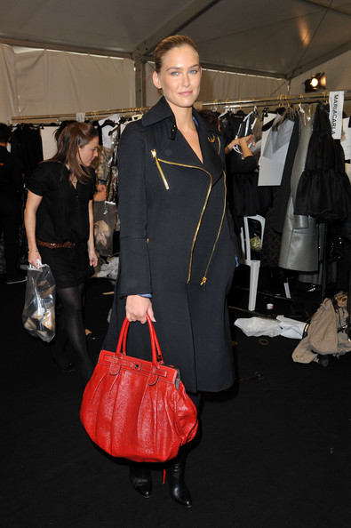 Super model Bar Rafaeli wasn't on duty for this runway show, but she showed her support anyway. She came out to the coveted show in a black zipper trench coat and bright red leather tote bag.