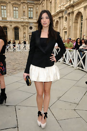 Daisy chose a black clutch with gold detail to match her black and white outfit.