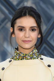 Nina Dobrev kept it casual with this mildly messy ponytail at the Louis Vuitton Fall 2019 show.