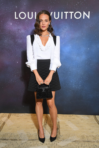 Alicia Vikander kept it ladylike in a white blouse with a ruffled neckline at the Louis Vuitton Stellar Jewelry event.