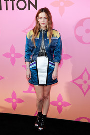 For her footwear, Riley Keough chose a pair of patent combat boots with metallic toe caps.