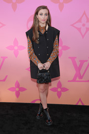 Emma Chamberlain donned an oversized black vest for the Louis Vuitton X: An Immersive Journey event.