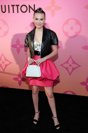 For her shoes, Millie Bobby Brown chose a pair of black ankle-strap sandals with bedazzled heels.
