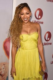 Meagan Good paired a gold tube clutch with a strapless yellow dress for the screening of 'Love by the 10th Date.'