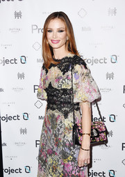 Georgina Chapman brought her ultra-feminine style to the Love Affair with World Oceans Day event with this floral-embroidered bag and lace dress combo.