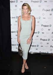 Alexandra Richards glammed up her casual dress with a pair of gold glitter heels.