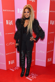 Mary J. Blige added more oomph with a pair of sequined thigh-high boots by Christian Louboutin.