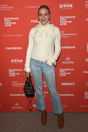 Chloe Sevigny donned a white cable-knit turtleneck sweater, made sweeter with the addition of some ruffles along the yoke, for the Sundance Film Fest premiere of 'Love & Friendship.'