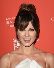 Kate Beckinsale styled her hair into a loose top knot with eye-grazing bangs for the Sundance Film Fest premiere of 'Love & Friendship.'