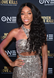 Lil Mama wore waist-length, side-swept curls at the New York premiere of 'When Love Kills: The Falicia Blakely Story.'