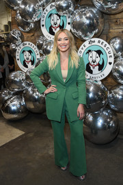 Hilary Duff teamed a green pantsuit with a nude top for Love Leo Rescue's Cocktails for a Cause.