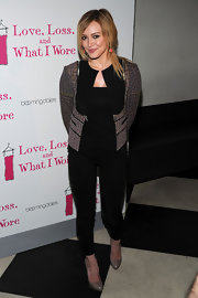 Hilary Duff paired her black leggings with a tweed cropped jacket.