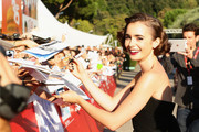 Lily Collins channeled Audrey Hepburn with this short curly 'do at the 'Love, Rosie' screening.