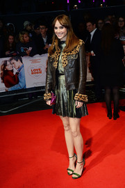 Suki Waterhouse arrived for the 'Love, Rosie' premiere wearing a leather bomber jacket with fur lapels and cuffs.