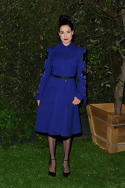 Dita was true blue in this royal coat dress adorned with heavy black beading down the sleeves.