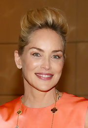 To complement her peach dress, Sharon donned a fleshy peach eye shadow at the 'Lovelace' press conference.