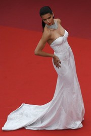 Adriana Lima stole the spotlight in a strapless white corset gown from Naeem Khan's Spring 2018 Bridal Collection at the Cannes Film Festival screening of 'Loveless.'