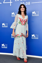 Penelope Cruz oozed boho charm in a pale blue Temperley London lace maxi dress with floral embroidery at the Venice Film Festival photocall for 'Loving Pablo.'