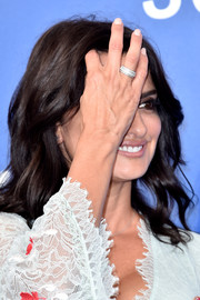 Penelope Cruz glammed up her look with a wide-band diamond ring at the Venice Film Festival photocall for 'Loving Pablo.'
