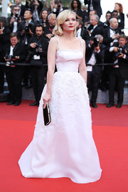 Kirsten Dunst was the picture of elegance in a white Christian Dior Couture princess gown, featuring spaghetti straps and delicate flower appliques, at the Cannes premiere of 'Loving.'