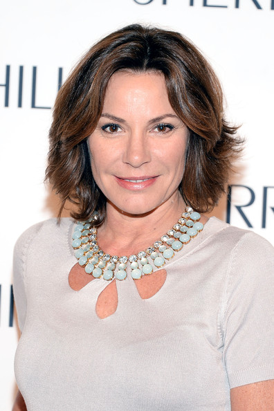 LuAnn de Lesseps Layered Razor Cut [hair,face,hairstyle,eyebrow,chin,layered hair,brown hair,lip,blond,shoulder,luann de lesseps,sherri hill,front row,new york city,mercedes-benz fashion week,sherri hill fashion show]