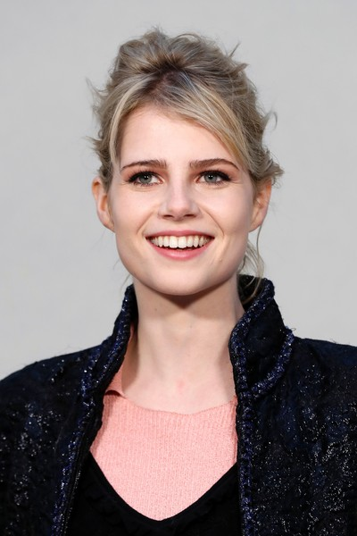 Lucy Boynton Messy Updo [collection,hair,face,hairstyle,eyebrow,lip,beauty,chin,blond,smile,forehead,chanel 2017,lucy boynton,francois guillot,haute couture spring summer,british,paris,chanel : outside arrivals,afp,paris fashion week]