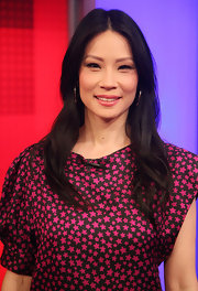 Actress Lucy Liu made an appearance on 'Fox & Friends' to promote her new film, 'Kung Fu Panda 2', wearing 18-karat gold Glamazon hoop earrings.