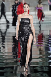 Joan Smalls flashed her leg in a high-slit black leather dress by Ferragamo at the LuisaViaRoma CR runway show.