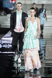 Bella Hadid was summer-glam in a tiered tie-dye-print wrap gown by Off-White at the LuisaViaRoma CR runway show.