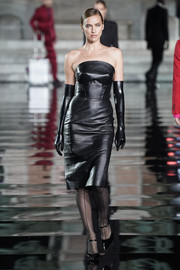 Irina Shayk rocked a strapless black leather dress by Ermanno Scervino at the LuisaViaRoma CR runway show.
