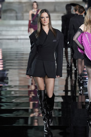 Alessandra Ambrosio was edgy-chic in a black Balmain tux dress with a matching corset belt at the LuisaViaRoma CR runway show.