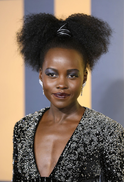 Lupita Nyong'o Curly Updo [european premiere of black panther,hair,face,hairstyle,black hair,beauty,eyebrow,afro,fashion,lip,model,red carpet arrivals,black panther,lupita nyongo,european,england,london,eventim apollo,premiere]
