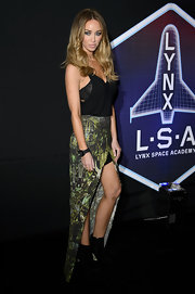 Lauren attended a Lynx promotional event wearing a wrap around skirt with an unusual print.