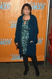 Rachel Dratch layered a lovely turquoise coat over her feminine floral dress.