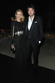 Natalia Vodianova knows how to have fun with fashion, and she did just that in this black gown with a funky metallic stone belt and slit cape-like sleeves.