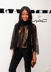 Genevieve Jones wore a trendy sheer lace cardigan to attend the MAC Cosmetics and Gareth Pugh Collaboration Cocktail soiree.