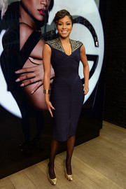Alicia Quarles was edgy-sexy in a black bandage dress with studded shoulders during the launch of Viva Glam Rihanna.