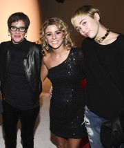 Miley Cyrus wore an edgy-glam leather and chain choker by Chanel to the world premiere of 'It's Not Over.'