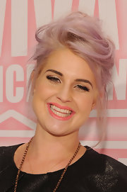 Kelly Osbourne wore her hair piled up into a casual cute 'do at the MAC Viva Glam party.