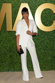Tiffany Haddish showed off a perfectly tailored white suit by Michael Kors at the MACRO pre-Oscar party.