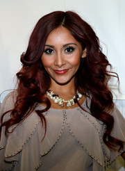 Nicole Polizzi styled her look with a chunky pearl and gemstone necklace.
