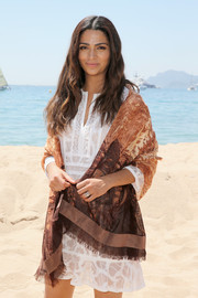 Camila Alves layered a patterned brown scarf over a little white dress for the Magnum and BCBG Max Azria event.
