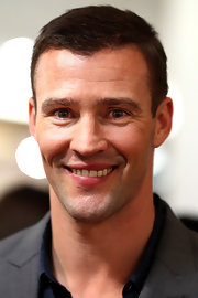 Kris Smith showed of his trademark good looks in a short boy cut in Sydney.
