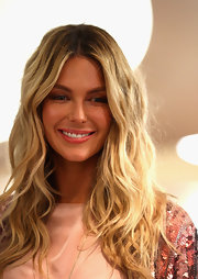 Jennifer Hawkins appeared in the Myer spring/summer show, part of the Mercedes Benz Fashion Festival in Sydney, Australia. She was the picture of effortless beauty with her long, wavy locks  tousled and flowing.