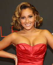 Adrienne Bailon was fabulously coiffed with sculpted curls when she attended the Style Awards.