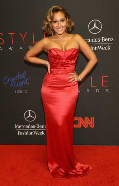 Adrienne Bailon went for an Old Hollywood feel in a sexy pink strapless gown when she attended the Style Awards.