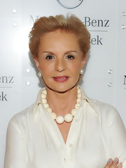 Carolina Herrera boldly accessorized with a statement necklace made of oversized beads during Mercedes-Benz Fashion Week.