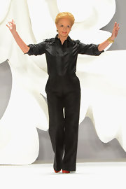 Carolina Herrera looked classic in a black button-down and slacks as she took a bow after her Spring 2013 fashion show.
