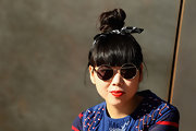 Susie Bubble styled her hair into an adorable top knot and accented it with a casual cotton scarf.